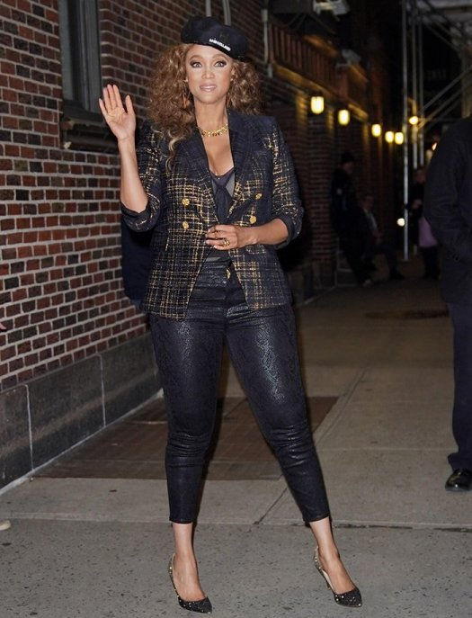 Tyra Banks flashes her cleavage as she exits The Late Show with Stephen Colbert studio