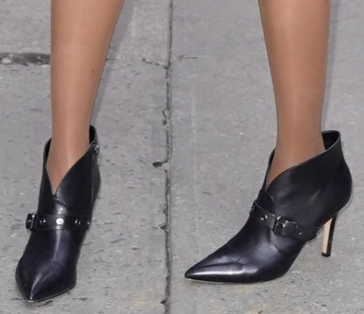 Tyra Banks slips into a pair of Nine West pointed-toe booties