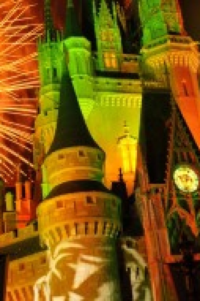 """Orange fireworks explode over Cinderella Castle while illuminated pumpkins are projected with light during the """"Happy HalloWishes"""" fireworks show. The show is part of """"Mickey's Not-So-Scary Halloween Party,"""" an after-hours Halloween celebration at the theme park. A separate ticket is required to attend. (Gene Duncan, photographer)"""