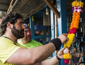 Nick Foti and Matt Guinta make a flower garland on Amazing Race Canada 3