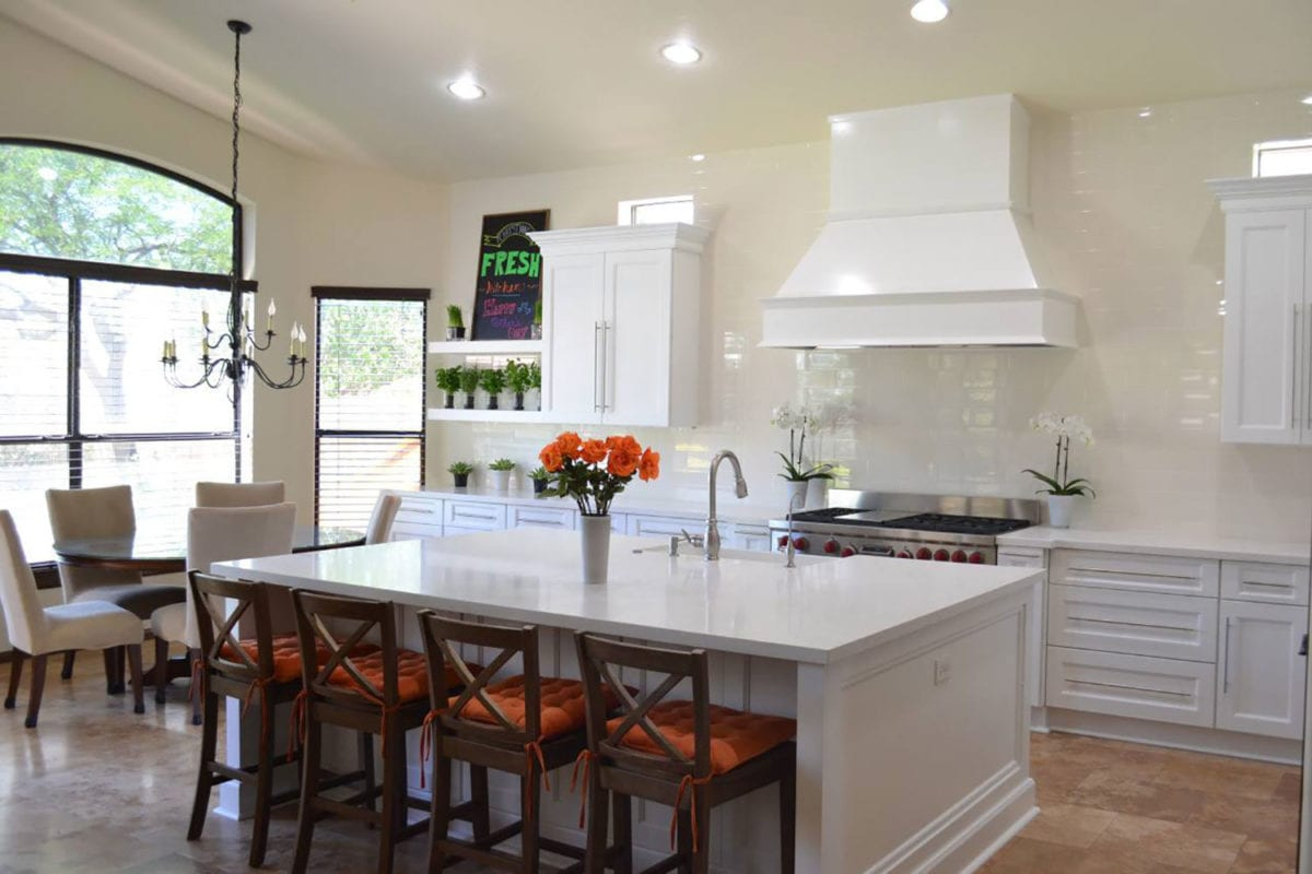 remodeled kitchen with white rangehood