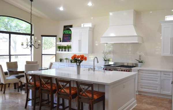 remodeled kitchen with white rangehood