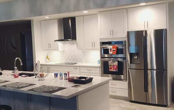 remodeled kitchen with stainless steel fridge and white countertops