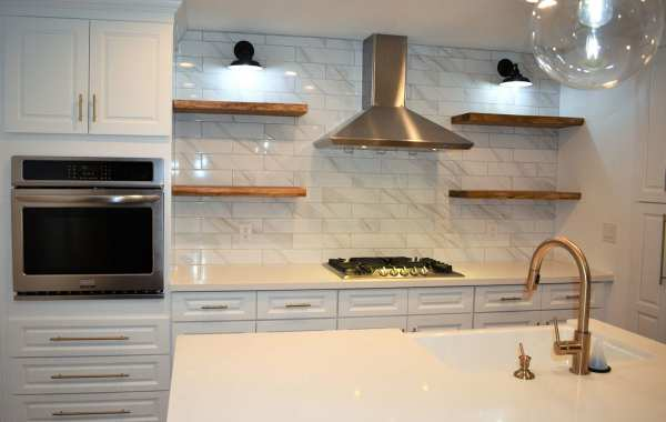 Remodeled kitchen with oven, stove, range hood