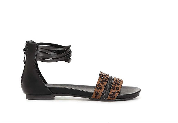 flat sandal in animalier print and black strips by Cafè Noir, 63,46 Euros