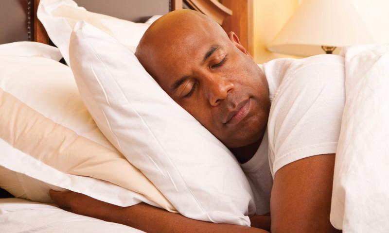 Man sleeping sleep weight management health