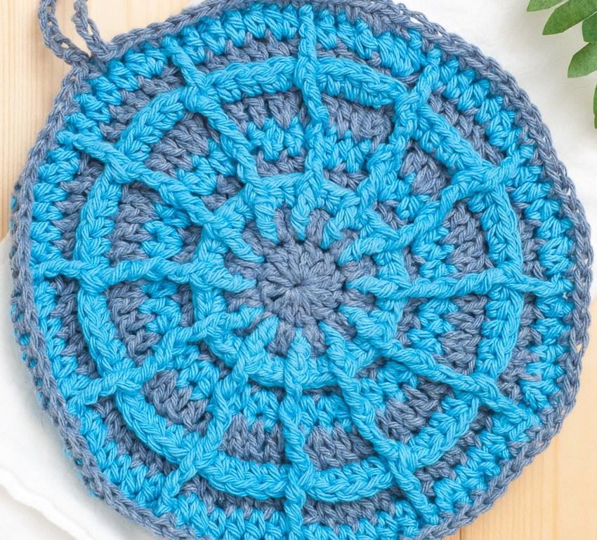 Blue, circular crochet potholder