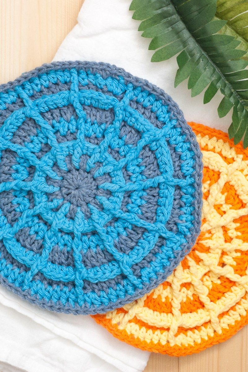 Orange and blue circular crocheted potholders