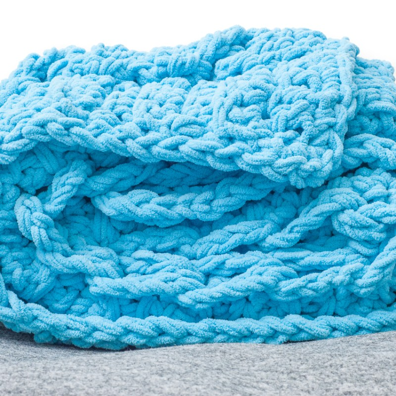 Chunky blue crochet blanket, folded