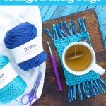 "two balls of dishie cotton yarn, scissors, mug rug, cup of tea, and a purple crochet hook with text ""beginner-friendly fringed mug rugs - free crochet pattern from you should craft"""