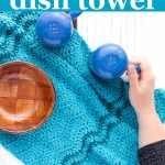 """hand holding a pepper shaker on a blue crocheted cloth with text """"easy ripple dish towel - beginner crochet pattern from you should craft"""""""