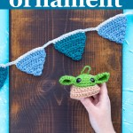 "small crocheted banner and grogu on a white towel with text ""baby yoda ornament - free crochet pattern from you should craft"""