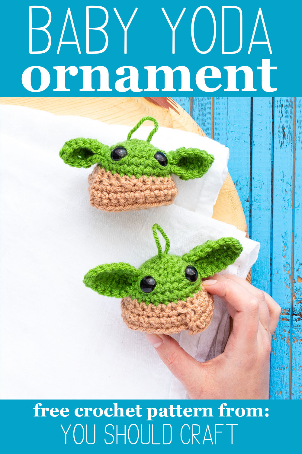 "two crochet grogu balls on a white background with text overlay ""baby yoda ornament - free crochet pattern from you should craft"""
