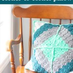 teal and grey crocheted pillow on a wooden chair with text overlay