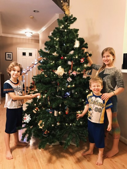 kids and christmas tree