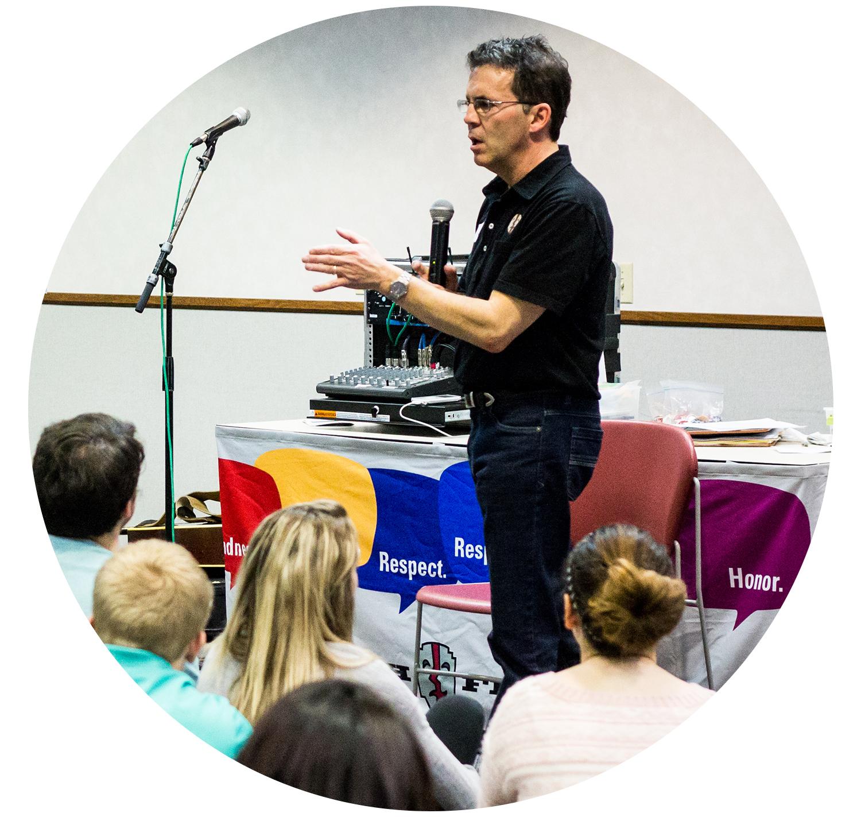 Joe Cavanaugh speaking to students on a microphone