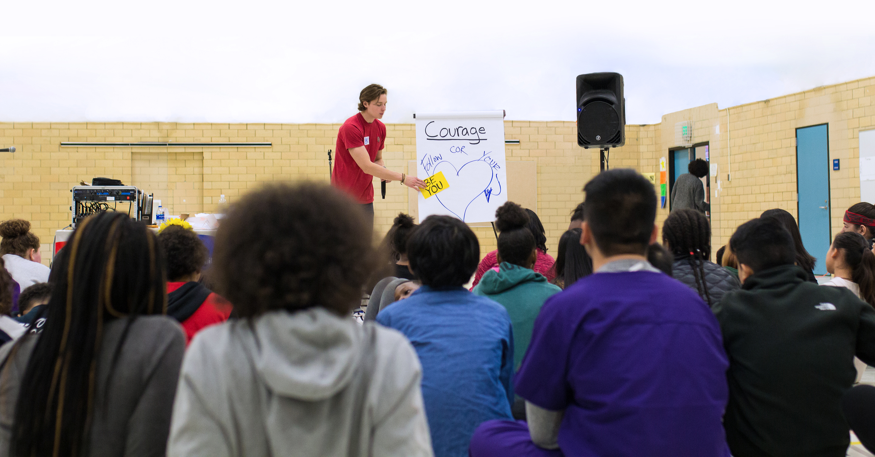 Retreat Facilitator, Jake, speaking about Courage at a seventh-grade Courage Retreat.