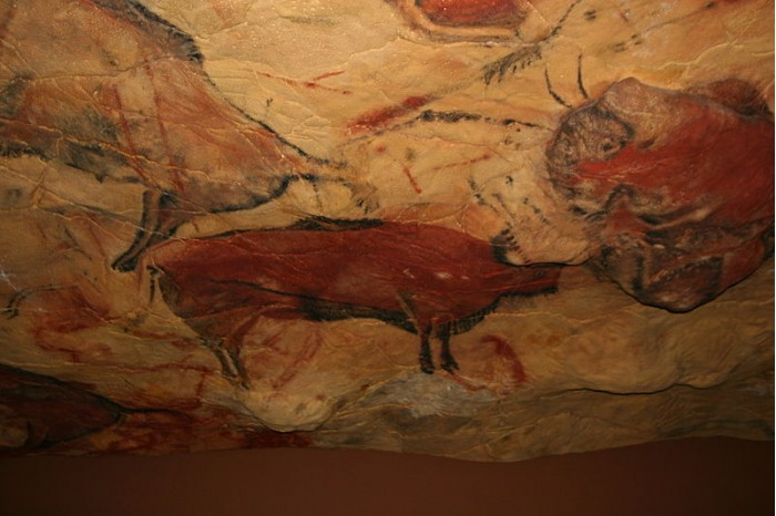 Why did the ancient cave painters deliberately put themselves in a state of hypoxia?