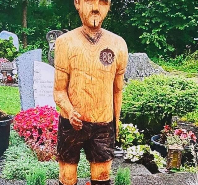 German man erected a statue on his father's grave, and was reported as being exactly like Hitler