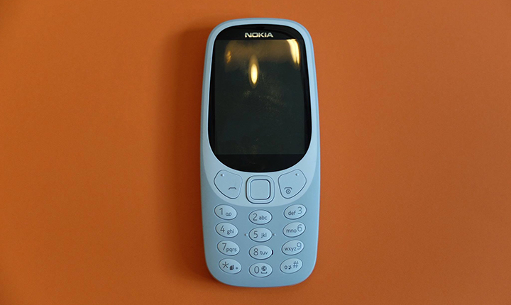 nokia 3330 2017. available colors are warm red and yellow, both with a gloss finish, dark blue grey in matte finish. nokia 3330 2017