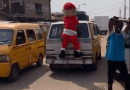 Santa Claus Spotted Hanging On A Moving Bus In Lagos