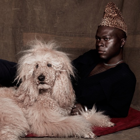 Pierre Kwenders with a poodle