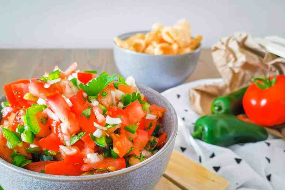 Keto Pico de Gallo ina bowl with pork rinds and other ingredients