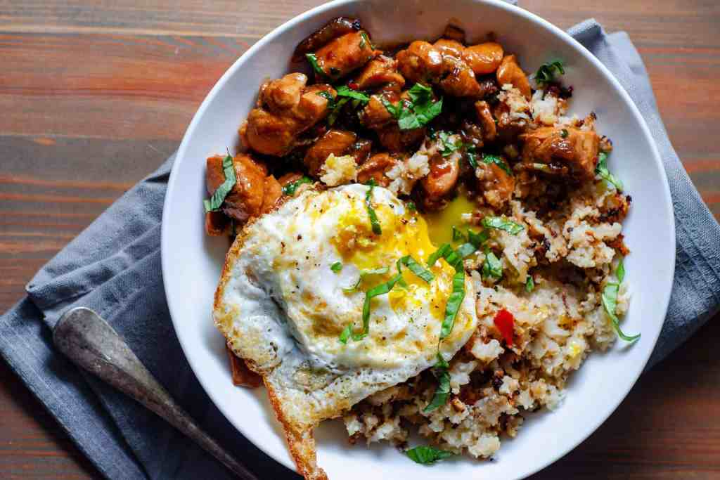 Low Carb Thai Basil Chicken with oven roasted cauliflower rice and a runny fried egg