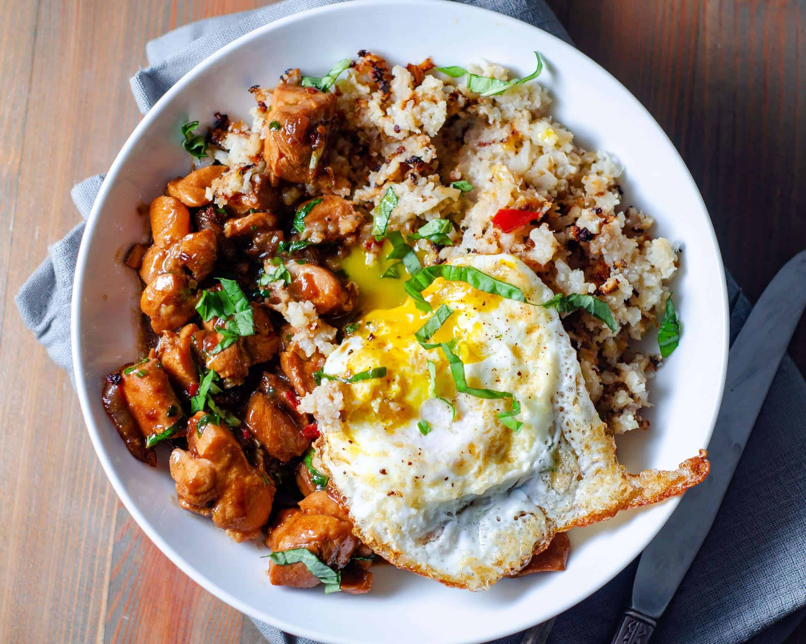 Low Carb Thai basil chicken with a fried egg and cauliflower rice