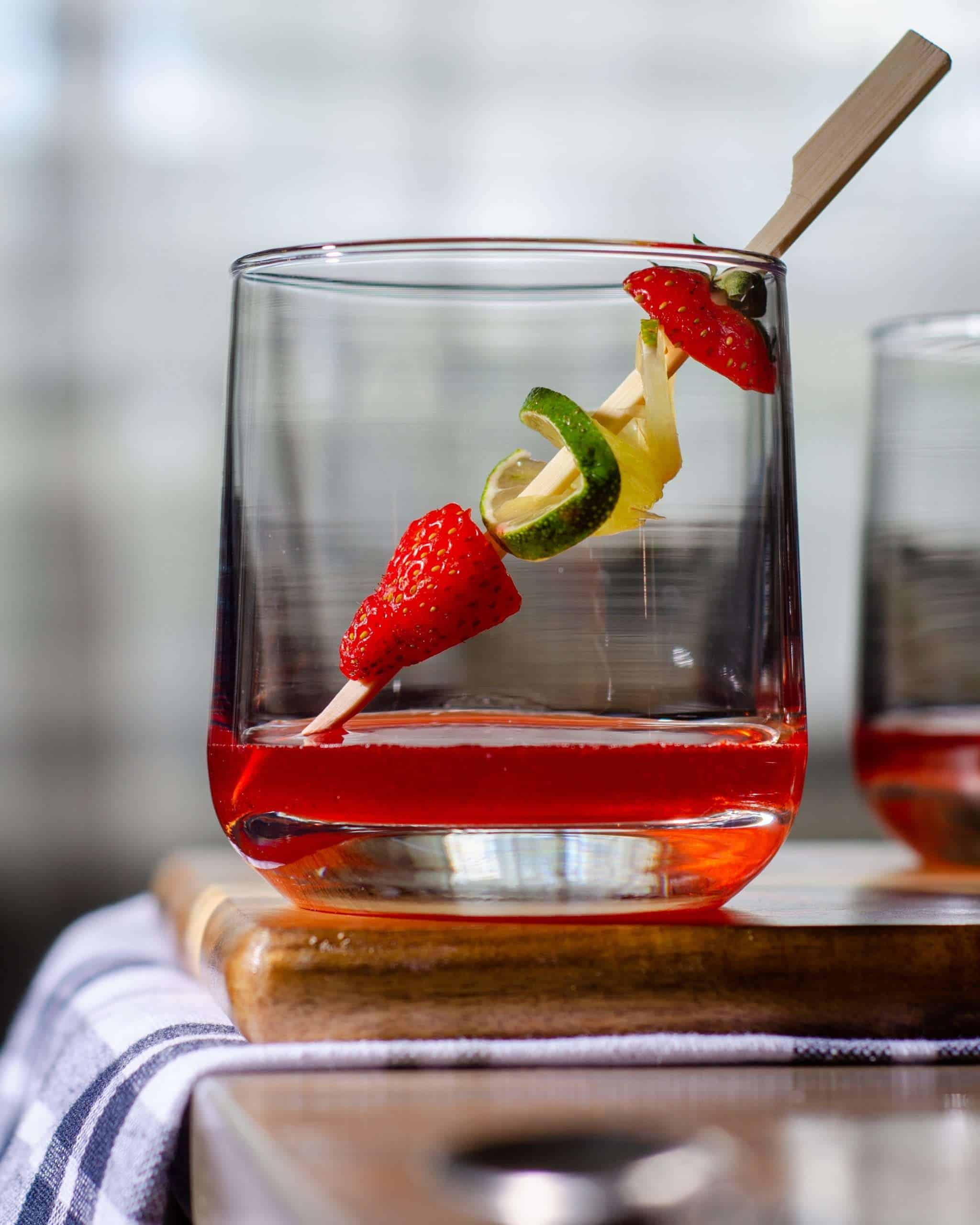 Strawberry simple syrup in a glass