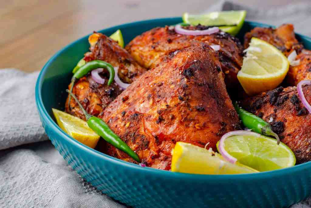 A platter of garnished low carb peri peri chicken