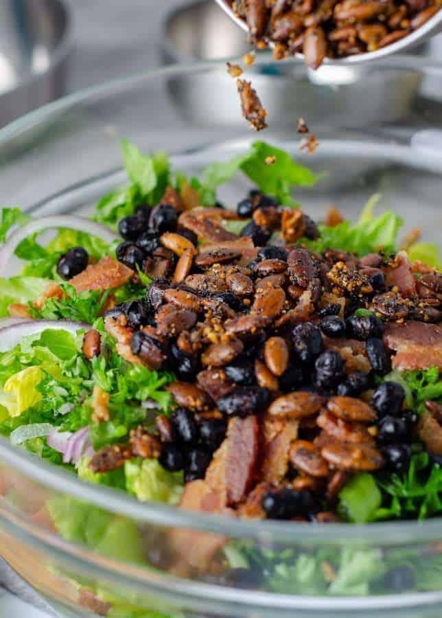 Toasted pepitas sprinkled over the ultimate keto Caesar salad