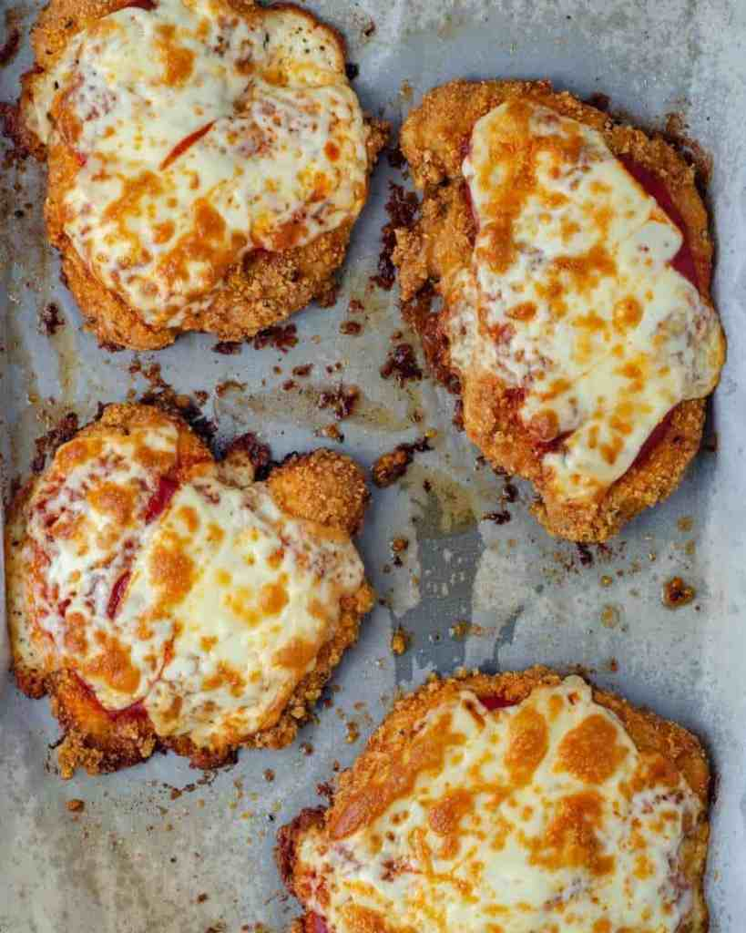 Oven Baked Chicken Parmesan on a baking tray