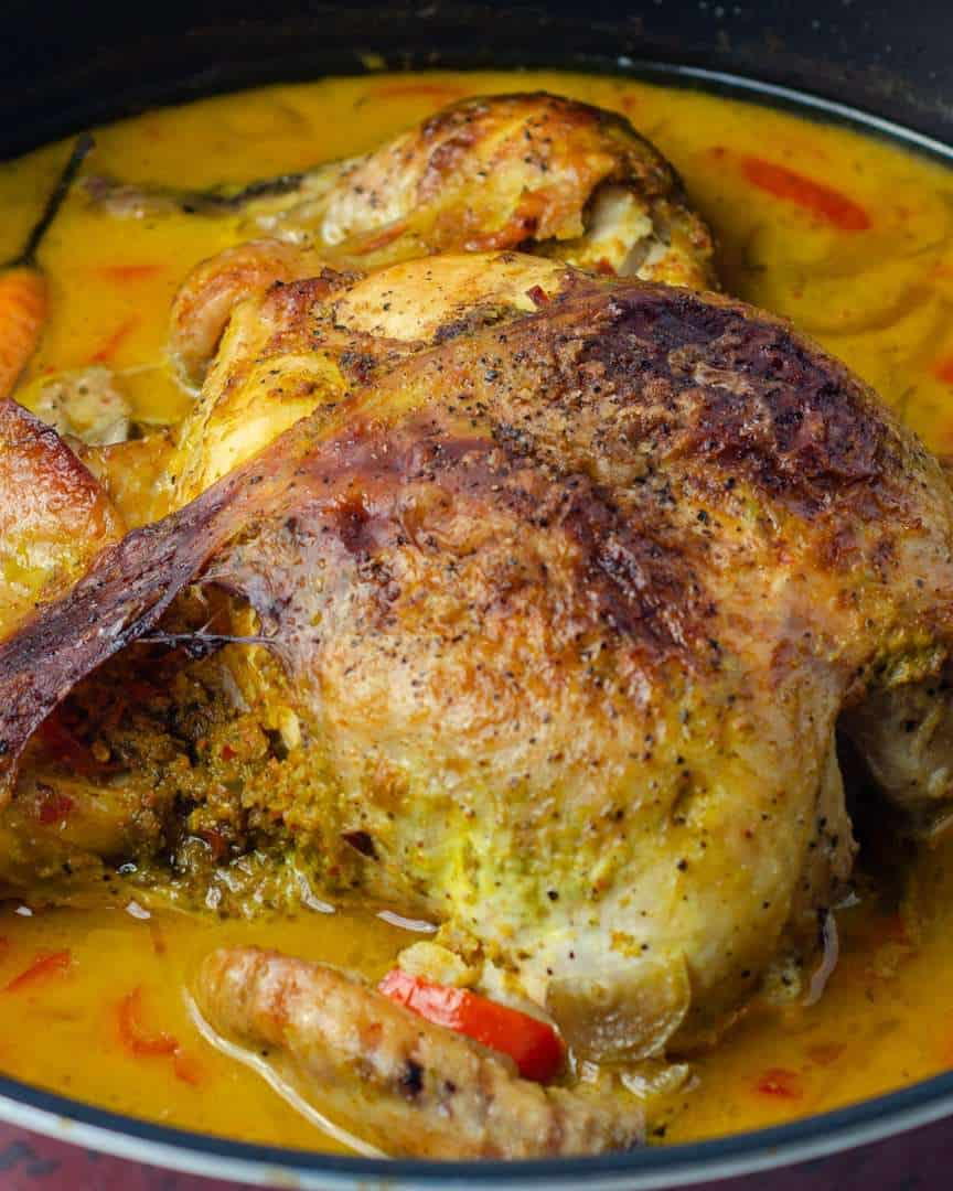 Braised whole chicken with crispy outer skin in a Thai coconut flavoured gravy