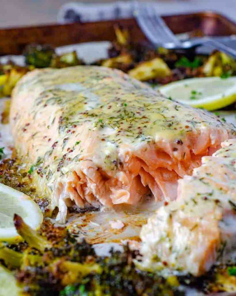 Sheet Pan Honey Dijon Salmon with broccoli on a tray