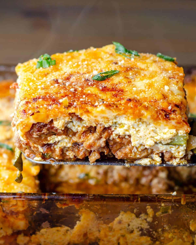 Ultimate keto lasagna sliced over the pan