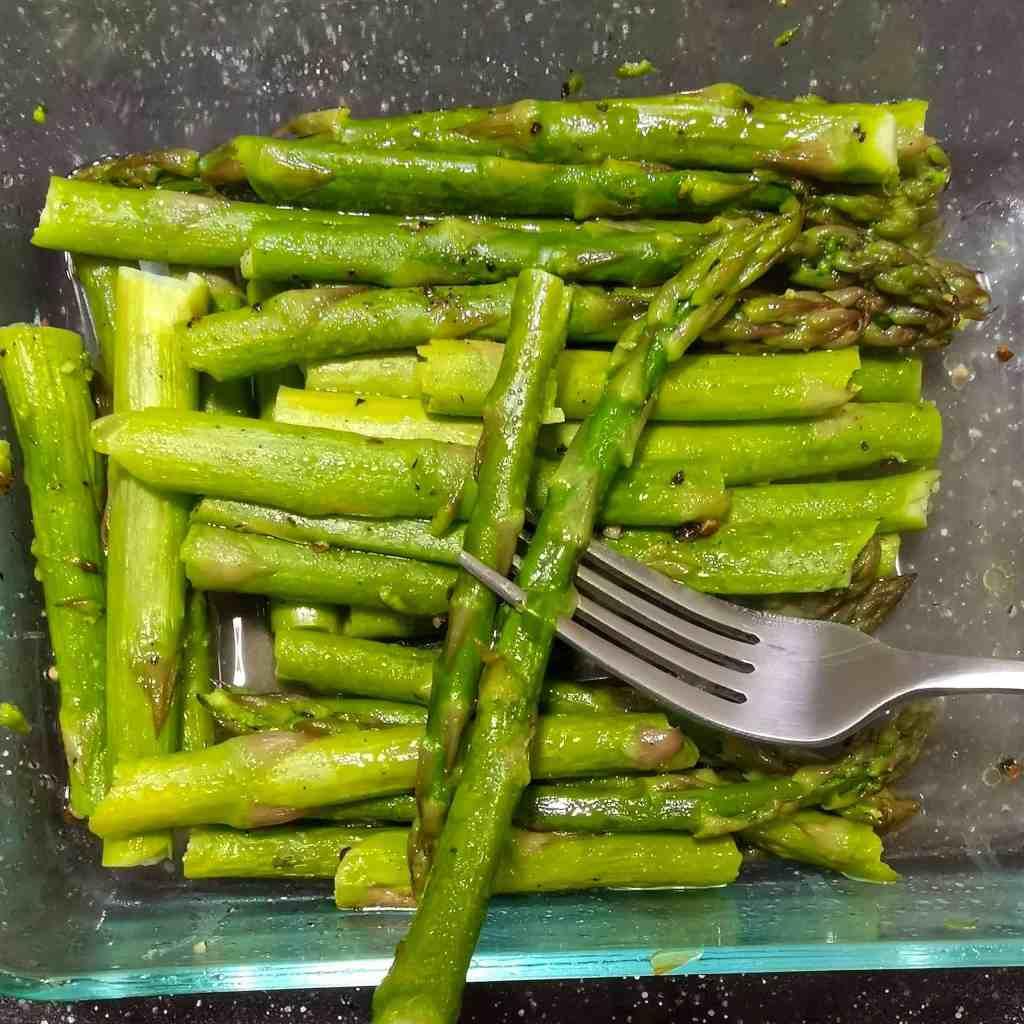 Microwave Steamed Asparagus on a fork