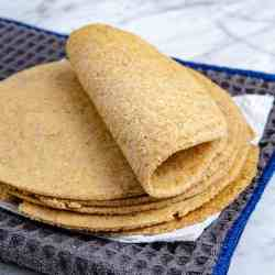 oat fiber and almond flour keto tortillas staked and folded.