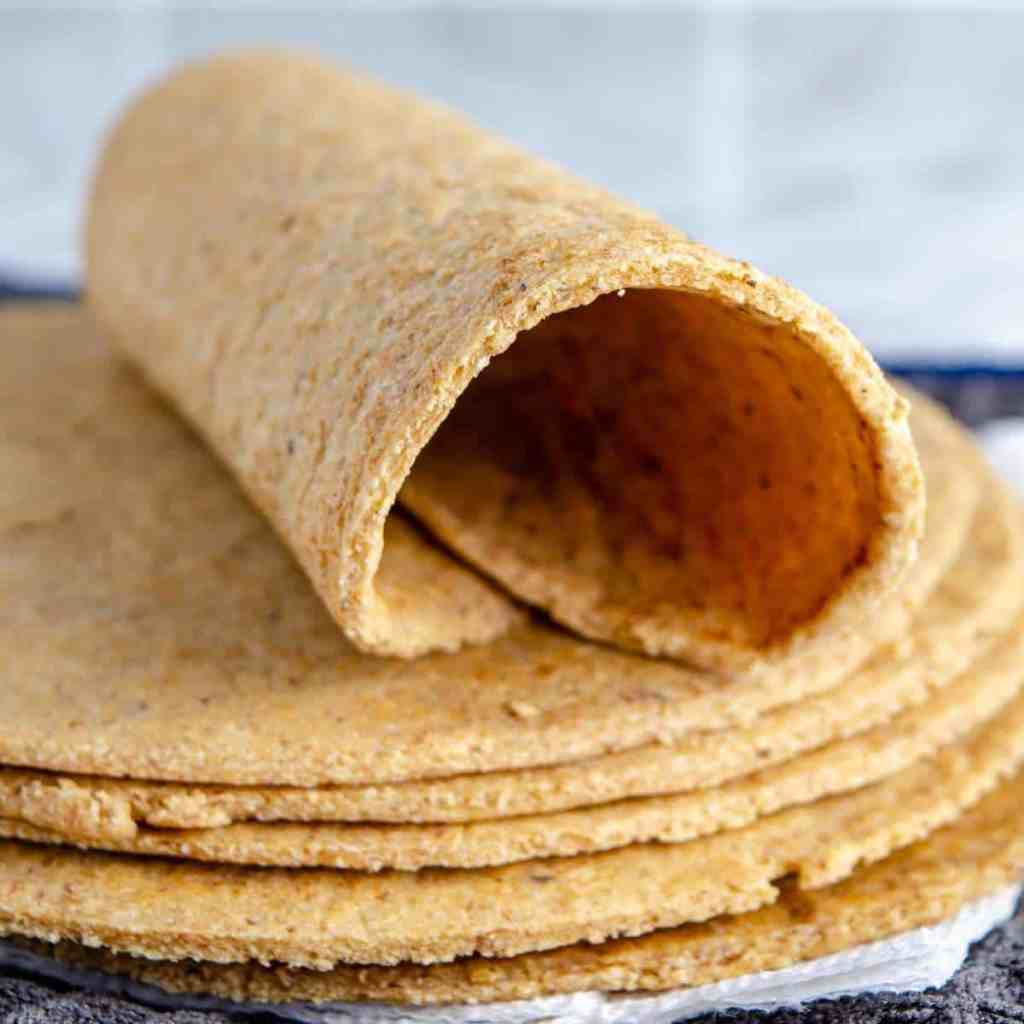 An oat fiber keto tortilla, curled into a burrito shape