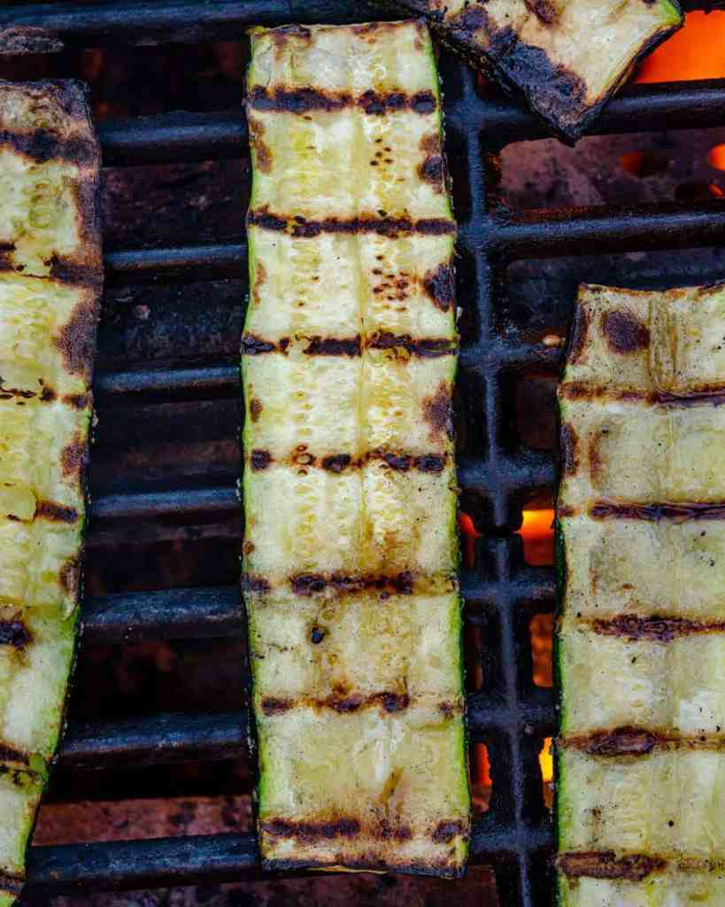 Slabs of sliced zucchini on a grill