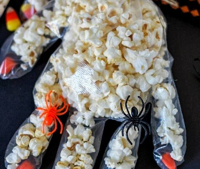 Fun Halloween Craft To Make With Kids Disposable Gloves With Candy Corn Fingernails Filled