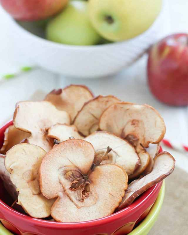 These Homemade Apple Chips are the perfect healthy snack for any time of the day! They're easy to make and you only need a few ingredients to make them. One of my favorite healthy snacks! (P.S. No dehydrator needed!)