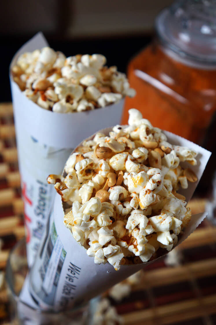 Guguru and Epa (Spicy Popcorn and Peanuts): Lagos Street Food traditionally wrapped in newspaper with a sprinkle of pepper