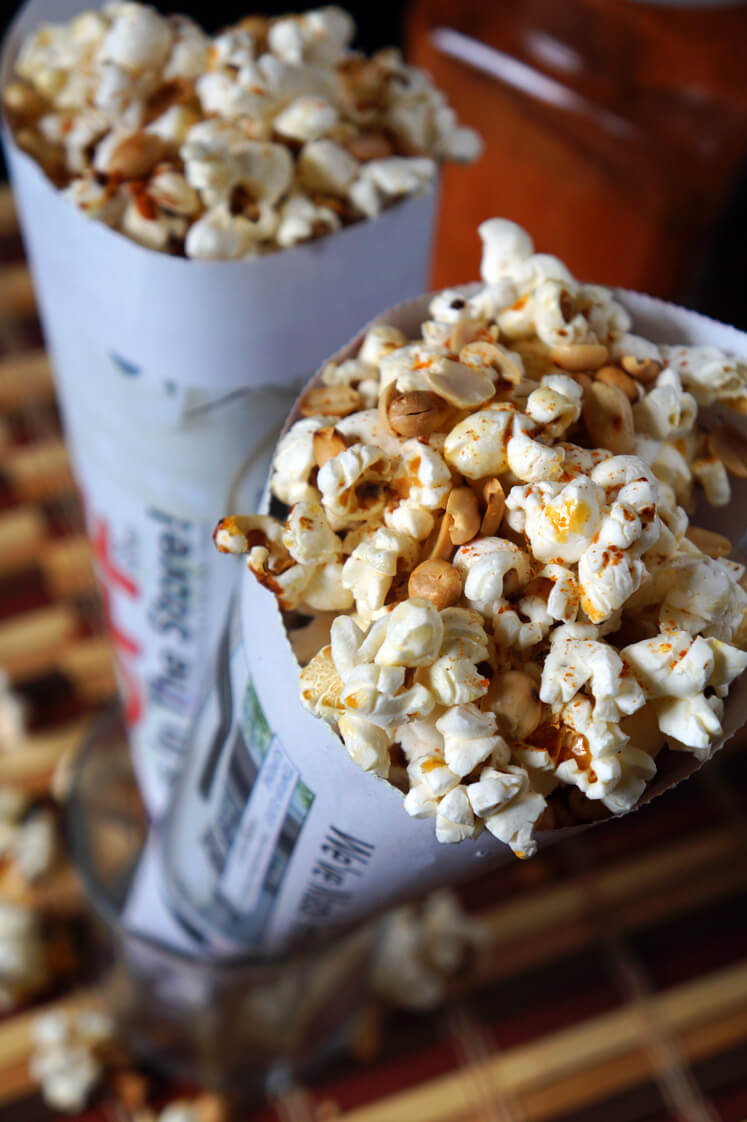 Nigerian Spicy Popcorn and Peanuts traditionally wrapped in newspaper