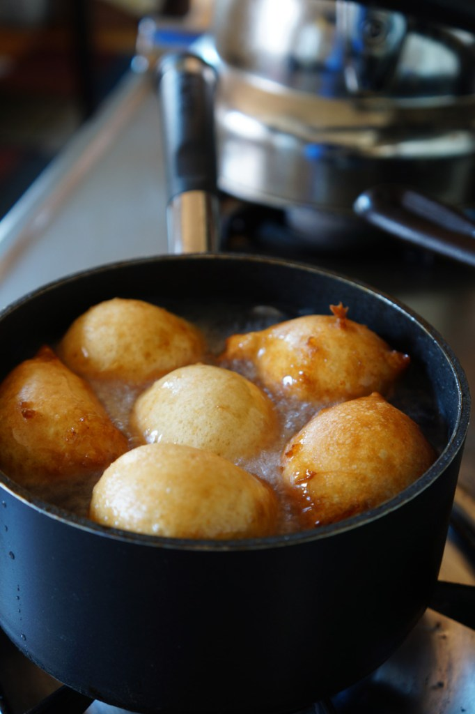 Puff-Puff: West African Spicy Drop Donuts - donuts beginning to brown in oil