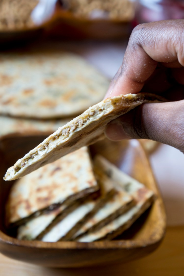 East African Chapati with Lamb - Holding the Kenyan keema chapati