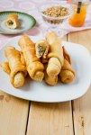 Cameroonian Fish Rolls - Stacked and plated n a table
