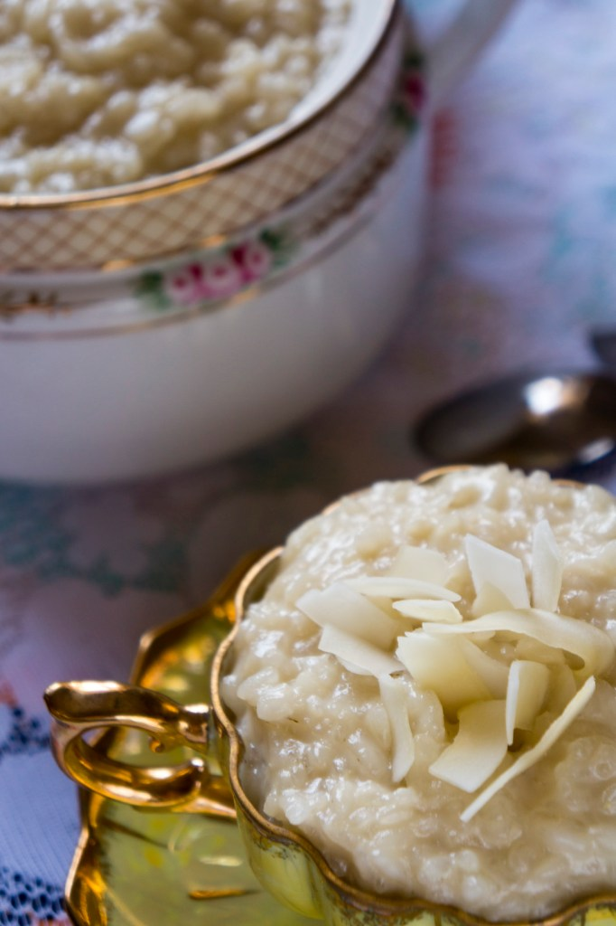 Senegalese Sombi: An Easy Coconut Rice Pudding - rice pudding in a cup with coconut flakes