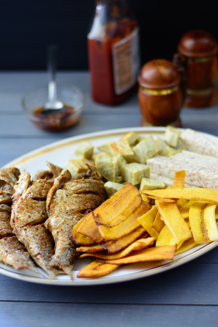 fried perch with fried sweet potato cubes, taro root, plantain chips