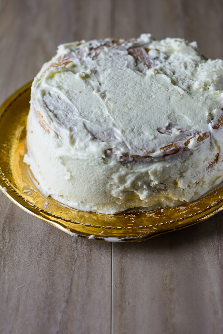 Coconut Caramel Cake: Moist and Delicious! - Cake covered with cream frosting
